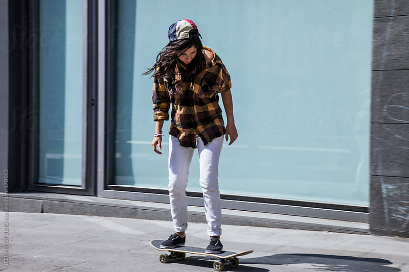 Young skater girl skating on the city. by BONNINSTUDIO for Stocksy United