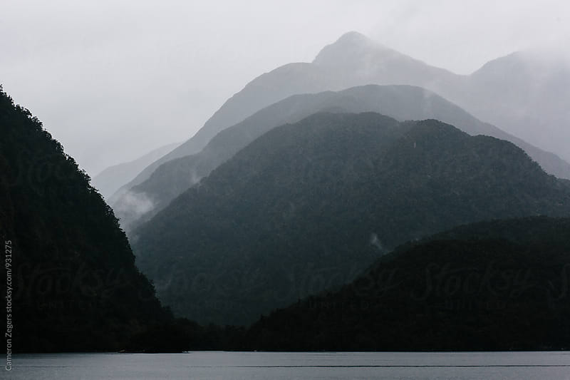 layers of mountains in fog by Cameron Zegers for Stocksy United