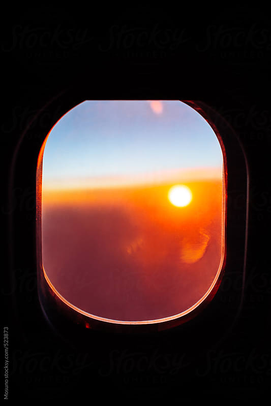 Sunset Through an Airplane Window by Mosuno for Stocksy United