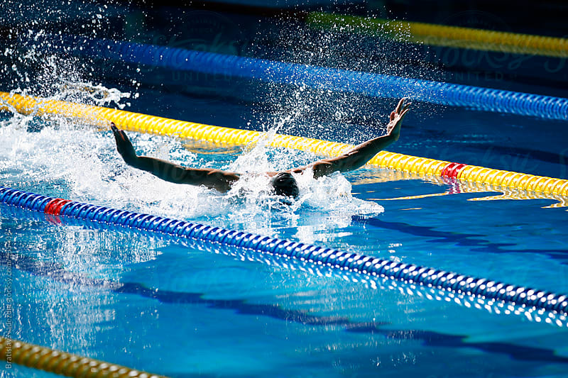 Male Swimmer Racing Toward Finish erforming Butterfly Stroke by Bratislav Nadezdic for Stocksy United