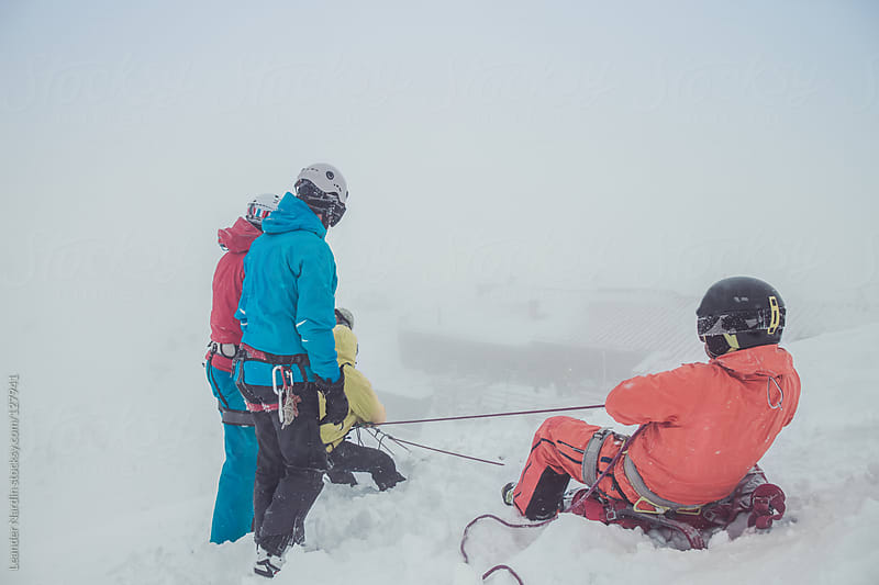 freeskier practicing emergency situation with a crevasses rescue by Leander Nardin for Stocksy United