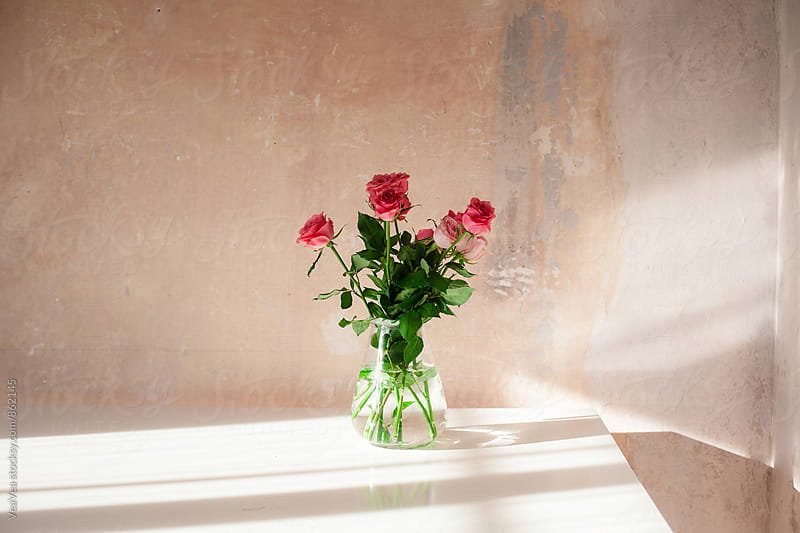 Bouquet of roses on a white table  by Marija Mandic for Stocksy United