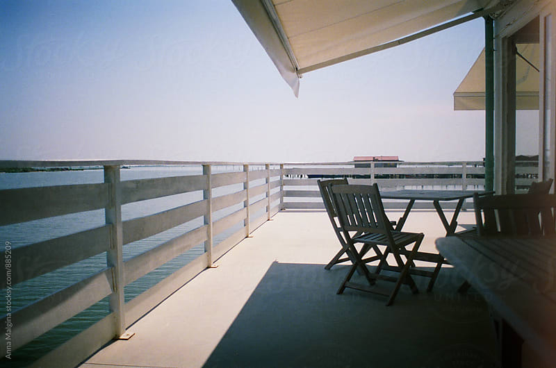 A film photo of a sunny veranda nearby sea by Anna Malgina for Stocksy United