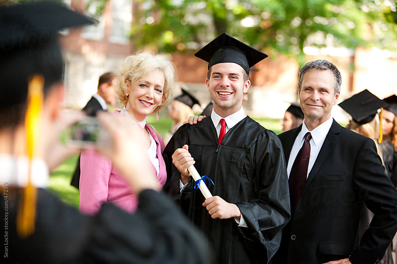 Graduation: Taking a Photo of a Family with a Graduate by Sean Locke for Stocksy United