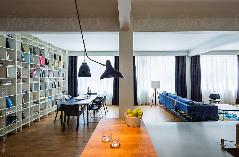 Spacious living room and kitchen in contemporary interior by Aleksandar Novoselski for Stocksy United