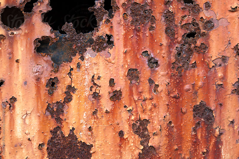 Rusty corrosion of metal due to prolonged exposure with open air by PARTHA PAL for Stocksy United