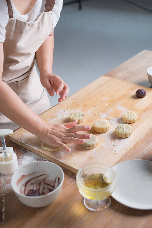 A young Chinese woman is making Moon cake for Mid-Autumn festival by Maa Hoo for Stocksy United
