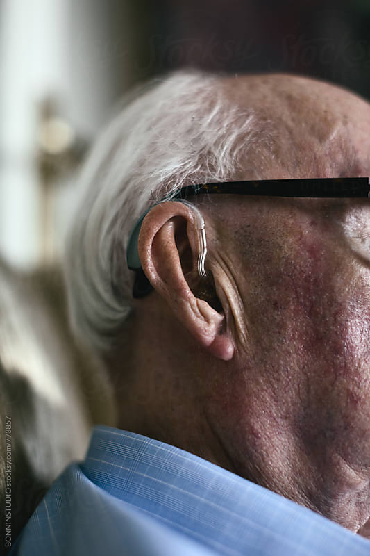 Closeup of an elderly man with a hearing aid. by BONNINSTUDIO for Stocksy United