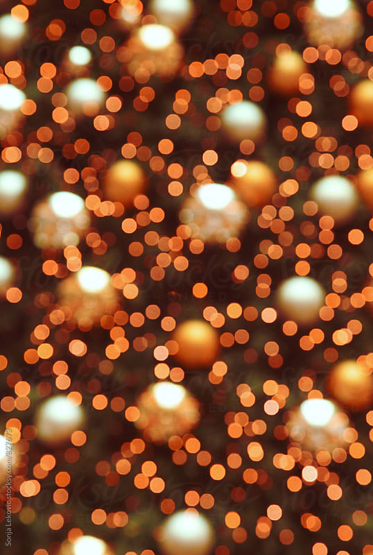 christmas tree orange lights blur background by Sonja Lekovic for Stocksy United