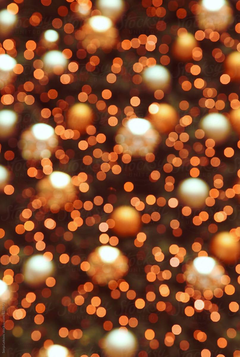 christmas tree orange lights blur background by sonja lekovic for stocksy united
