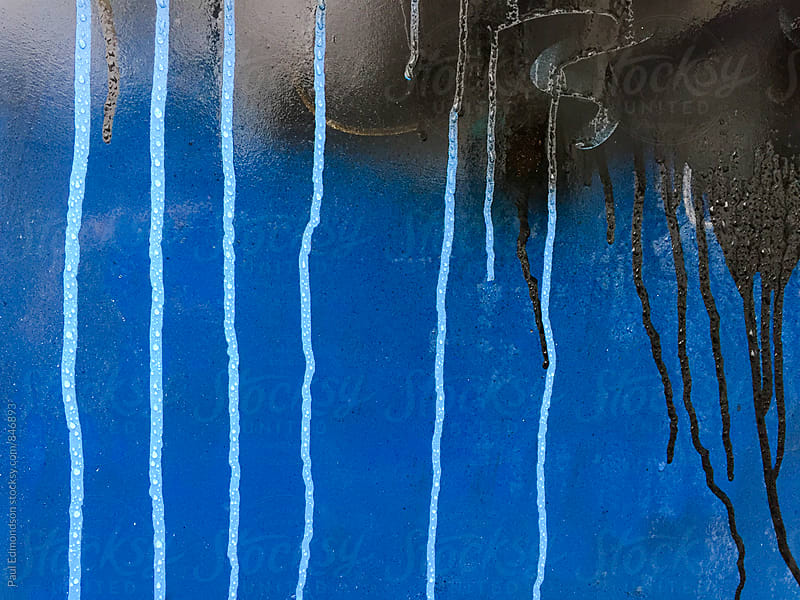 Graffiti paint dripping on wall, close up by Paul Edmondson for Stocksy United