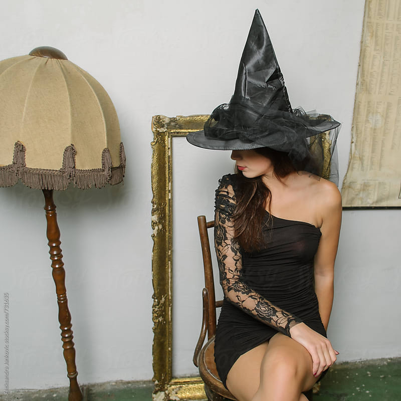 Attractive Brunette Wearing Witch Costume for Halloween by Aleksandra Jankovic for Stocksy United