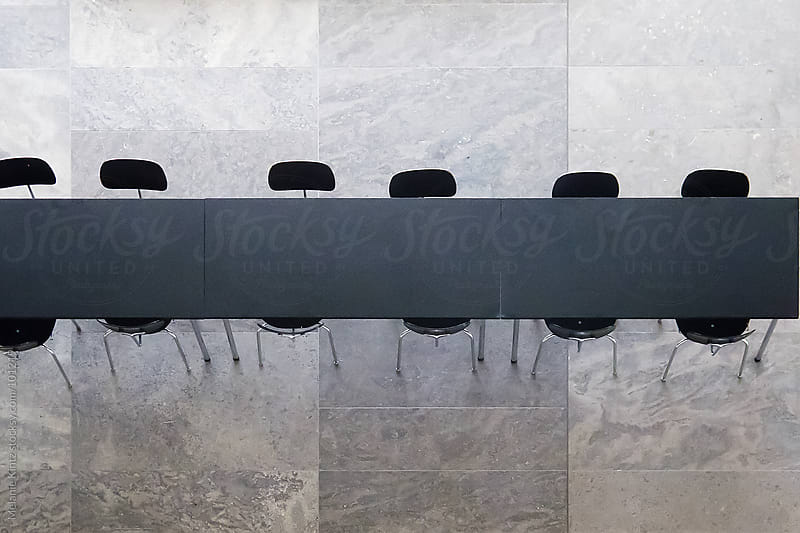 conference table with chairs by Melanie Kintz for Stocksy United