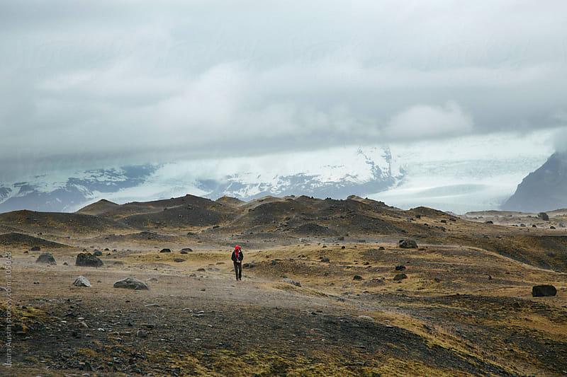 Woman Hiking Through A Foggy Landscape by Laura Austin for Stocksy United