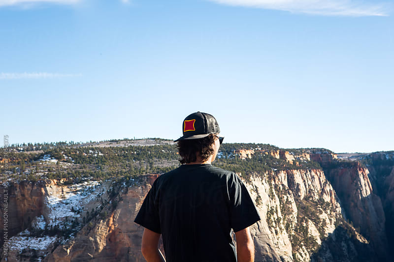Man with Hat and Vast Vista Views by MEGHAN PINSONNEAULT for Stocksy United