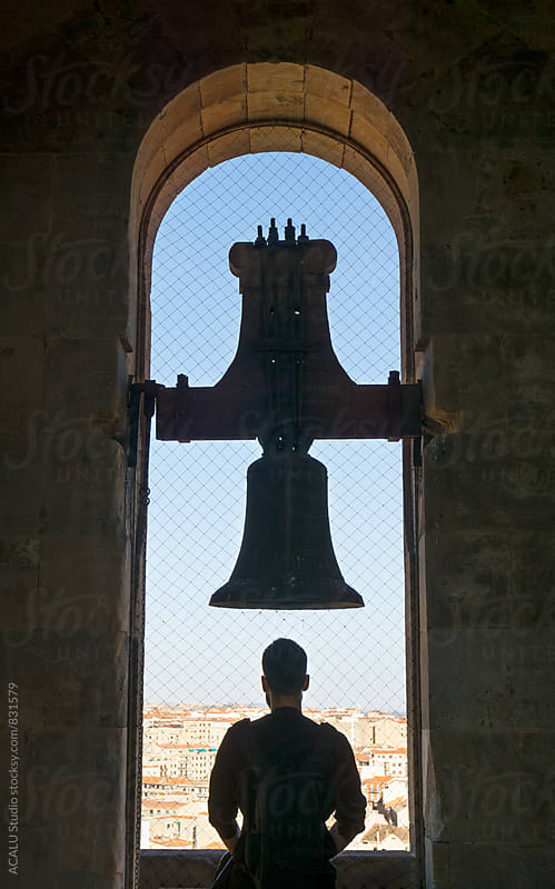 Man looking at the city from a bell tower by ACALU Studio for Stocksy United