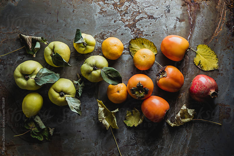 Persimmon, lemon, tangerine, pomegranate and quince  by Tatjana Zlatkovic for Stocksy United