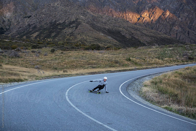 Skateboarder wrapping a corner in New Zealand by Gary Parker for Stocksy United