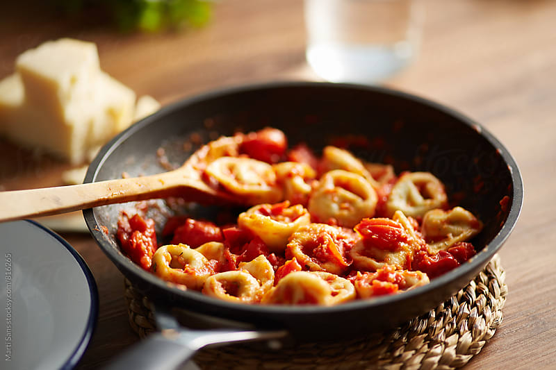 Tortellini with tomato sauce by Martí Sans for Stocksy United