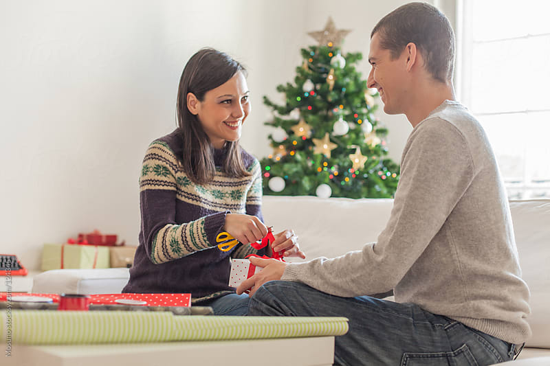 Wrapping Christmas Gifts at Home by Mosuno for Stocksy United