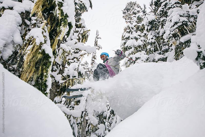 Skier braking a pillow of snow doing freeride ski by Alejandro Moreno de Carlos for Stocksy United