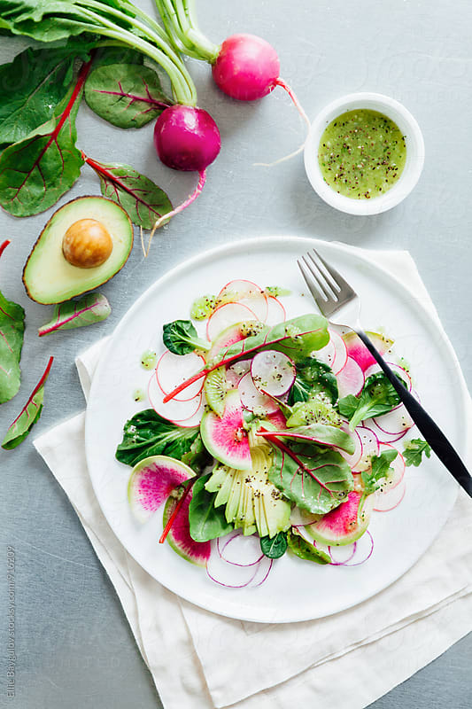Fresh radish salad by Ellie Baygulov for Stocksy United