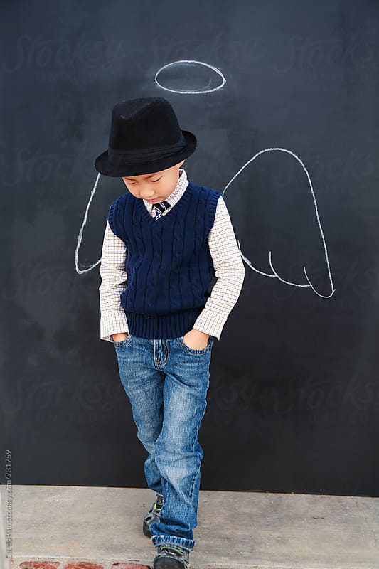 Little boy with angel wings and halo by Curtis Kim for Stocksy United