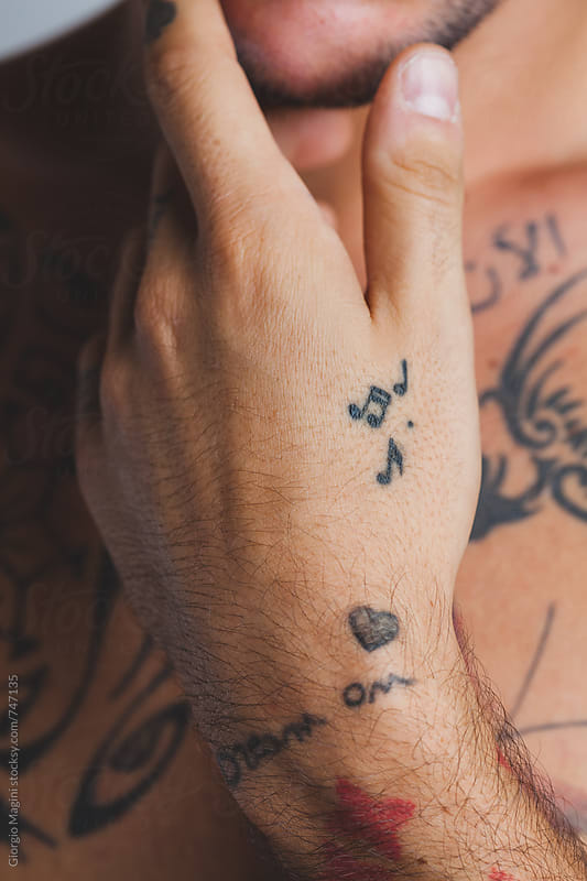Musical Notes Tattooed on the Hand of a Young Man by Giorgio Magini for Stocksy United