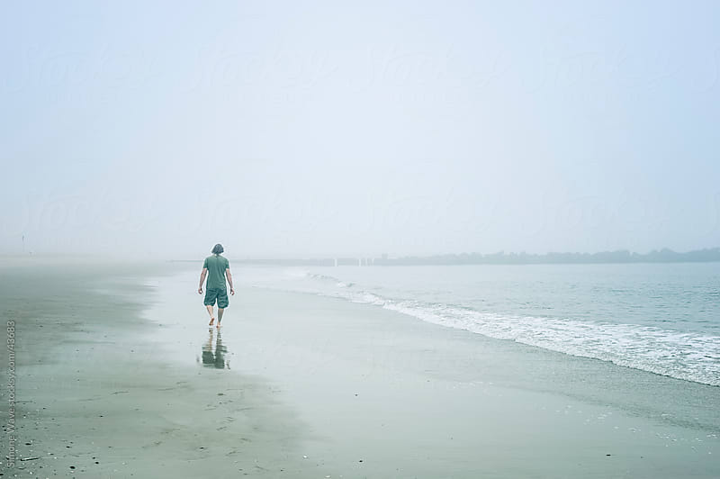 Lonely man on the beach by GIC for Stocksy United