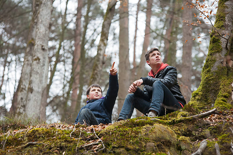 Teenage boys in the forest by Mima Foto for Stocksy United