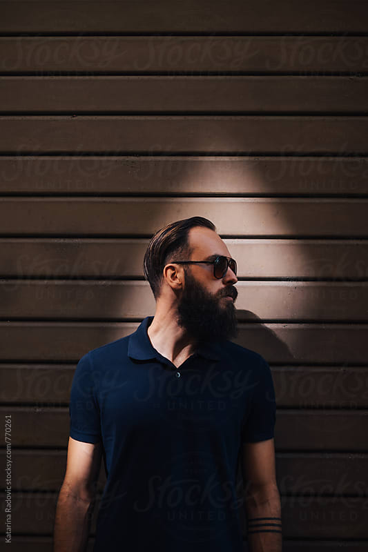 Portrait of a Handsome Bearded Man Wearing Sunglasses by Katarina Radovic for Stocksy United