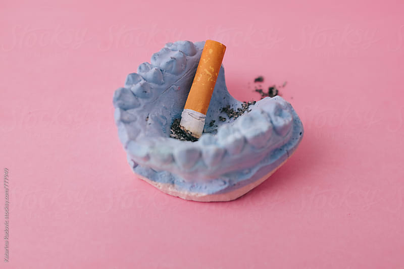 Cigarette Butt in Blue Jaw by Katarina Radovic for Stocksy United