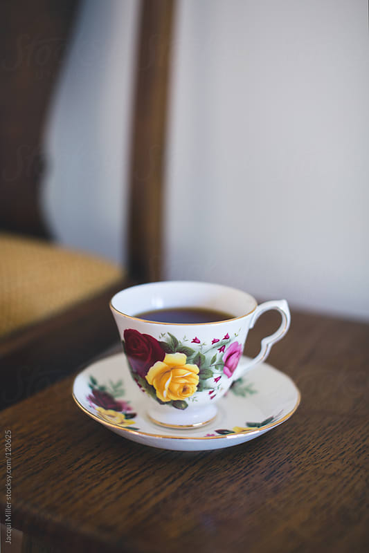 China teacup on an antique table by Jacqui Miller for Stocksy United