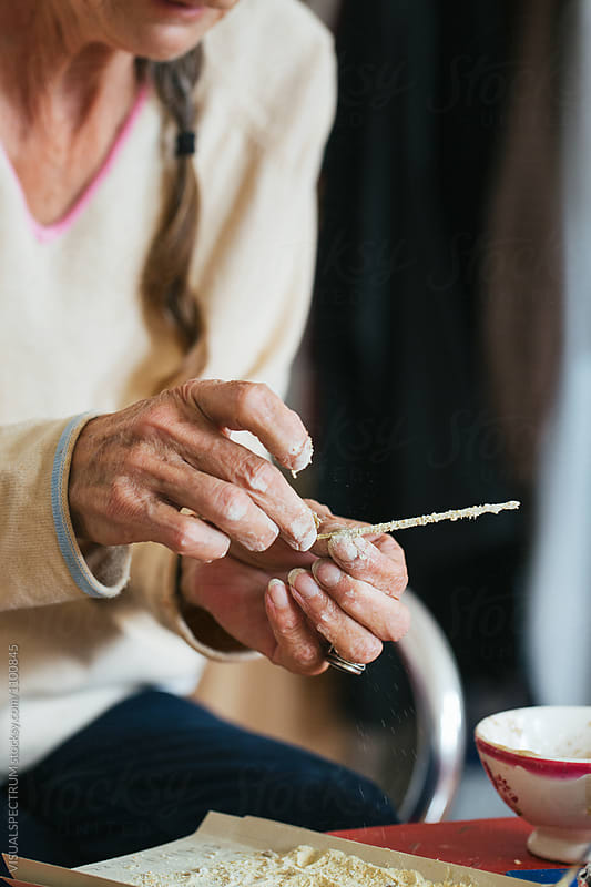 Close Up of Senior Woman Making Natural Incense Stick at Home by VISUALSPECTRUM for Stocksy United