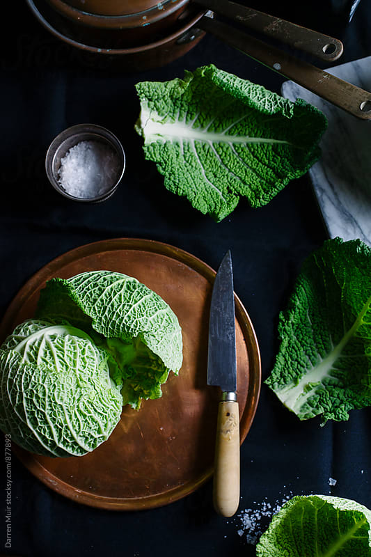 Preparing a savoy cabbage. by Darren Muir for Stocksy United
