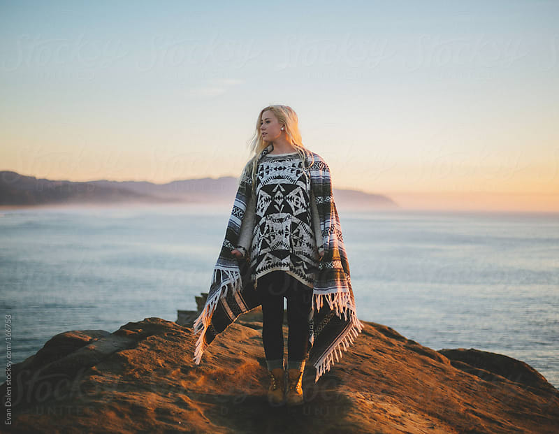 Young Blonde Woman on Coastal Cliff by Evan Dalen for Stocksy United