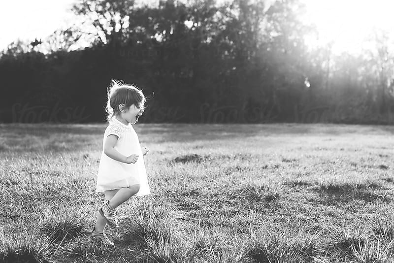 A Child Screaming With Excitement by Alison Winterroth for Stocksy United