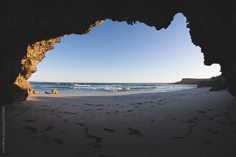 A cave shaped like Australia. by John White for Stocksy United