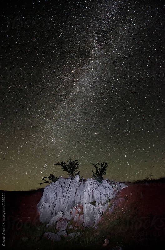 Night photo with milky way and rocks at the mountains by Cosma Andrei for Stocksy United