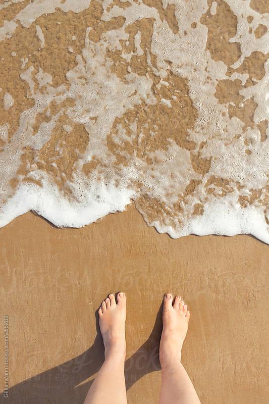 summer feet at the beach by Gillian Vann for Stocksy United