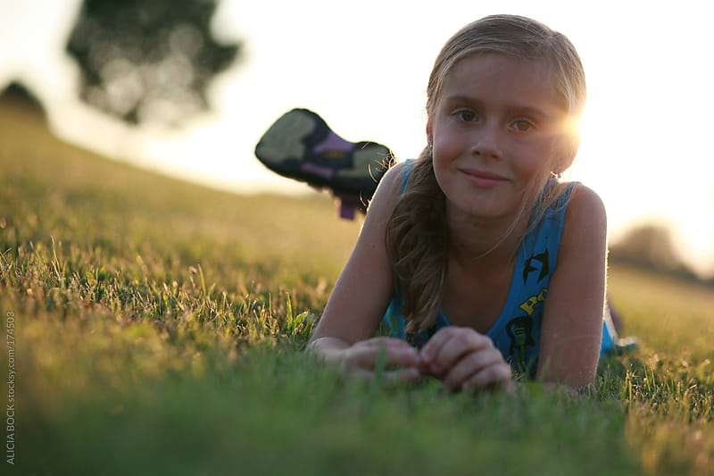 Girl In The Grass and Sun by ALICIA BOCK for Stocksy United