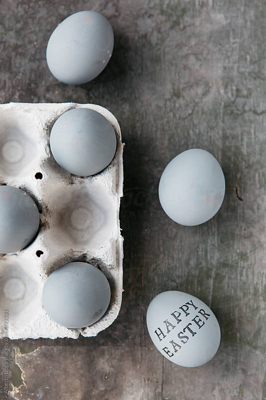Grey easter eggs on wooden background by Alberto Bogo for Stocksy United