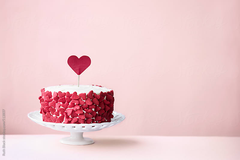 Valentines cake on a pink background by Ruth Black for Stocksy United