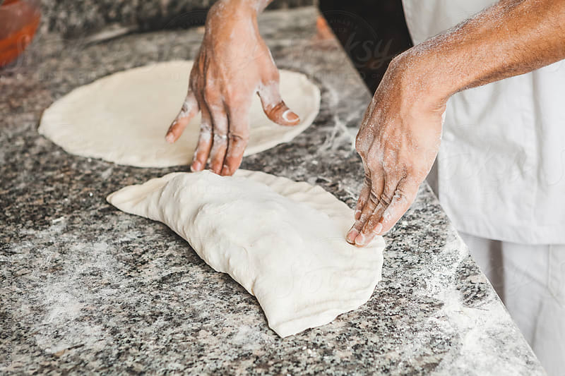 Making a Calzone Pizza Pressing with Hands by Giorgio Magini for Stocksy United