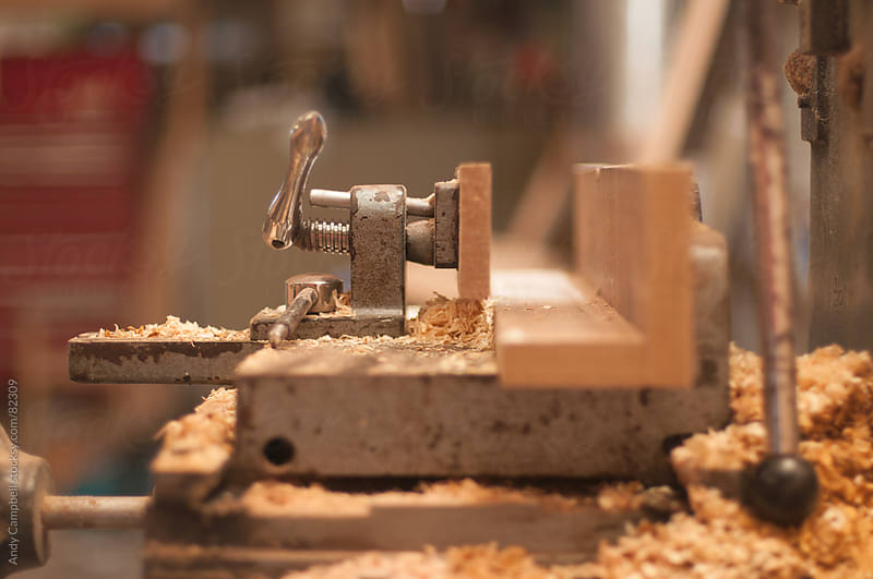 A hand vice on a workbench covered in sawdust by Andy Campbell for Stocksy United