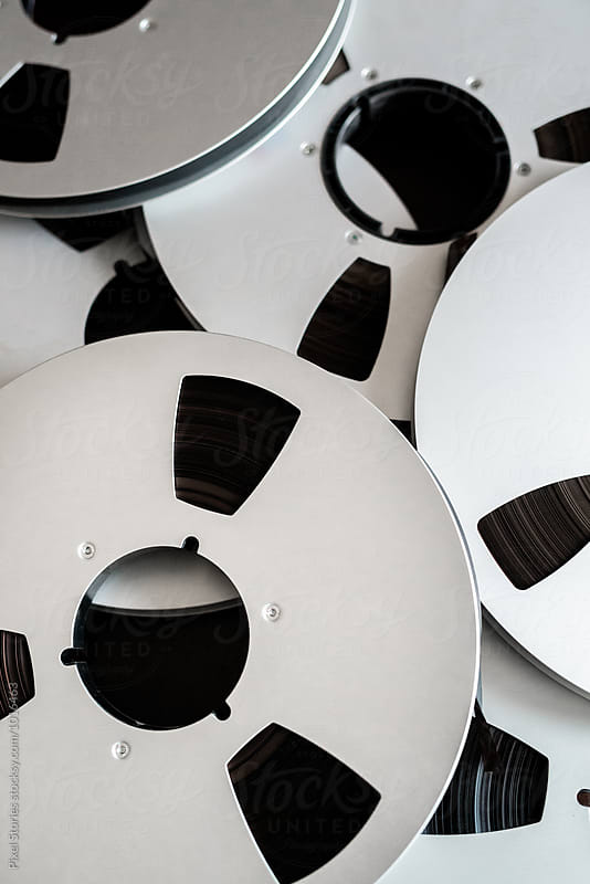 Reel of magnetic tape background by Pixel Stories for Stocksy United