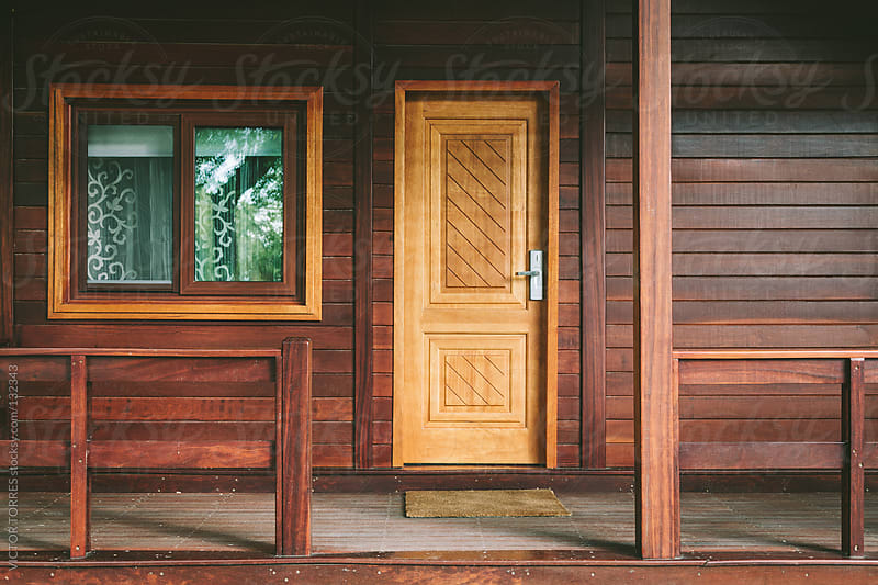 Entrance of a Wooden Cabin by VICTOR TORRES for Stocksy United