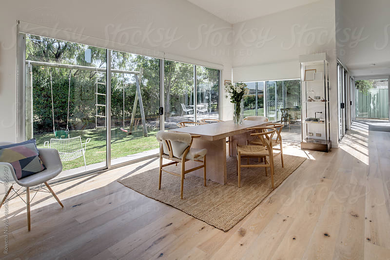 Contemporary dining room by Rowena Naylor for Stocksy United