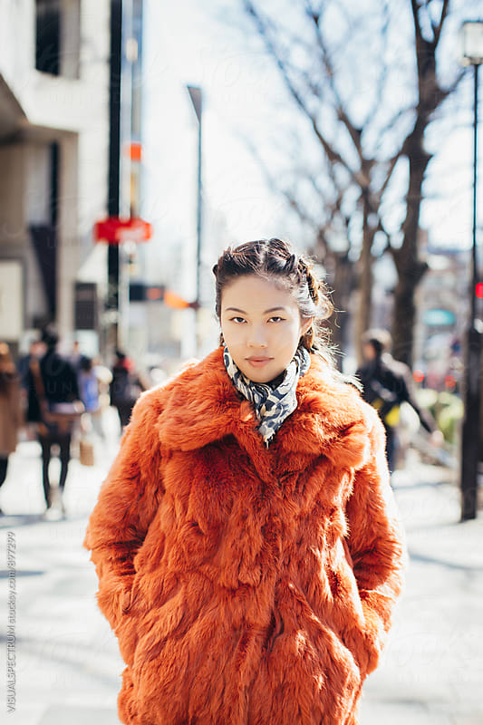 Portrait of Pretty and Fashionable Young Japanese Woman Standing in Tokyo Street by Julien L. Balmer for Stocksy United