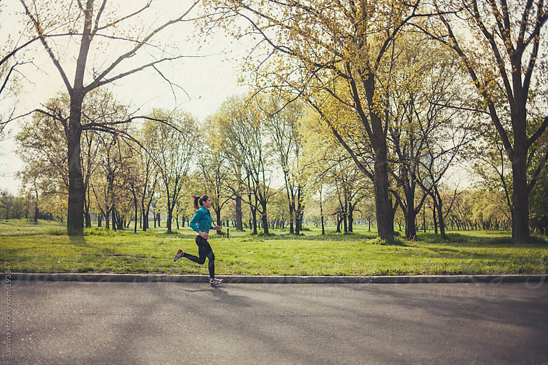 Woman Running in the Park by Lumina for Stocksy United